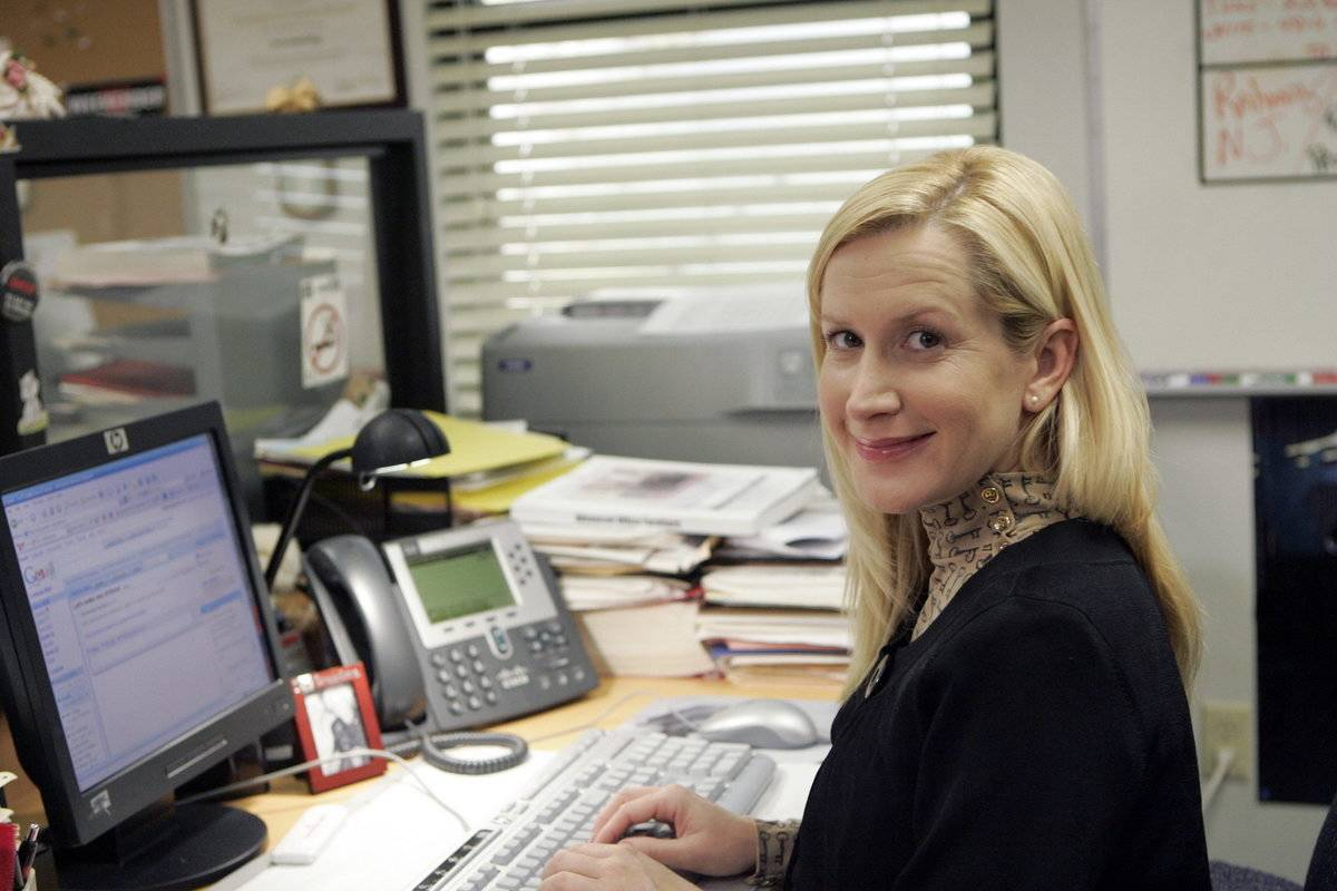Angela Kinsey Sat At Her Office Desk While Filming