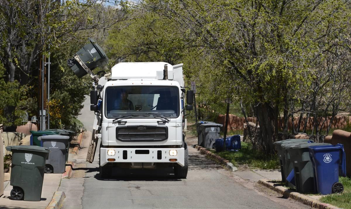 City garbage truck picks us refuse
