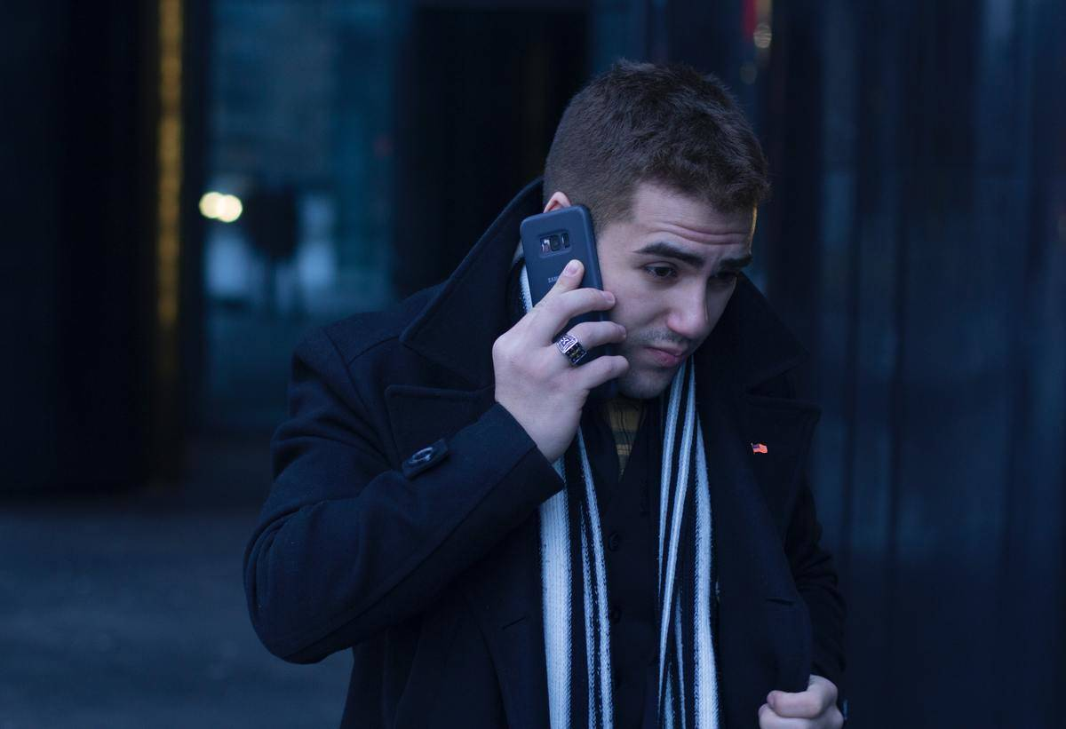 A man makes a call on his cellphone.