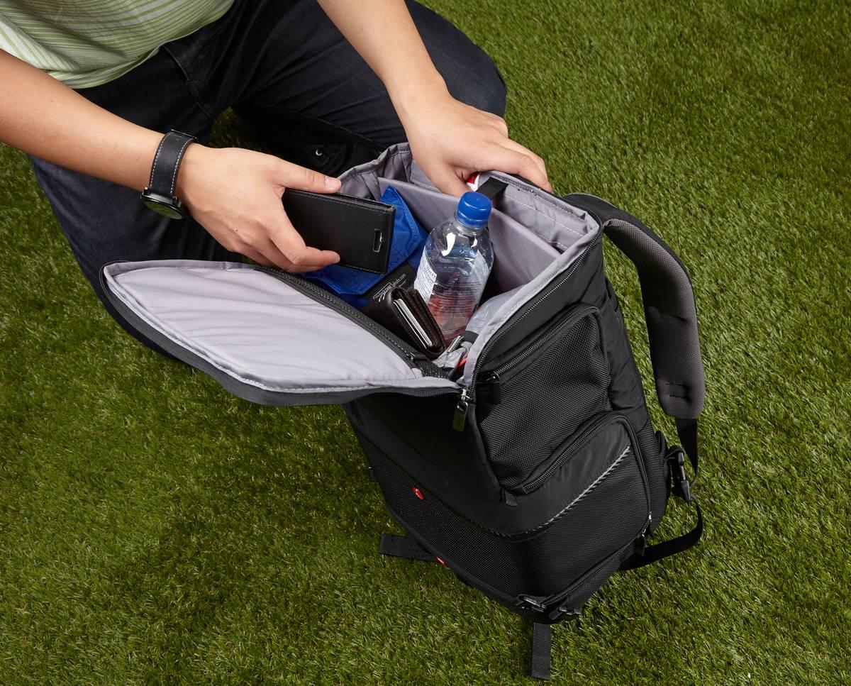 A man looks inside a backpack.