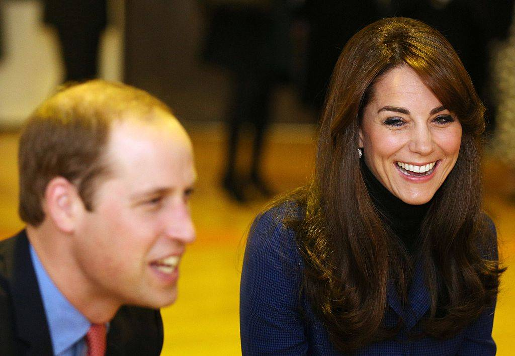Britain's Prince William, Duke of Cambridge (L) and wife Catherine, Duchess of Cambridge laugh as they visit Dundee Rep theatre
