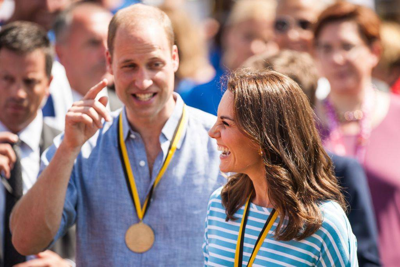 Britain's Princess Kate, the Duchess of Cambridge, and Britain's Prince William, Duke of Cambridge laugh