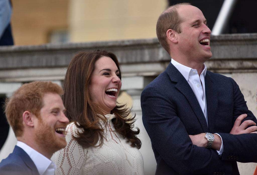 Prince Harry, Catherine, Duchess of Cambridge and Prince William, Duke of Cambridge laugh as they host a tea party