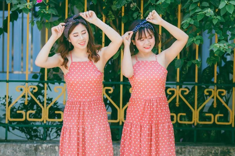 Two women wear matching outfits.