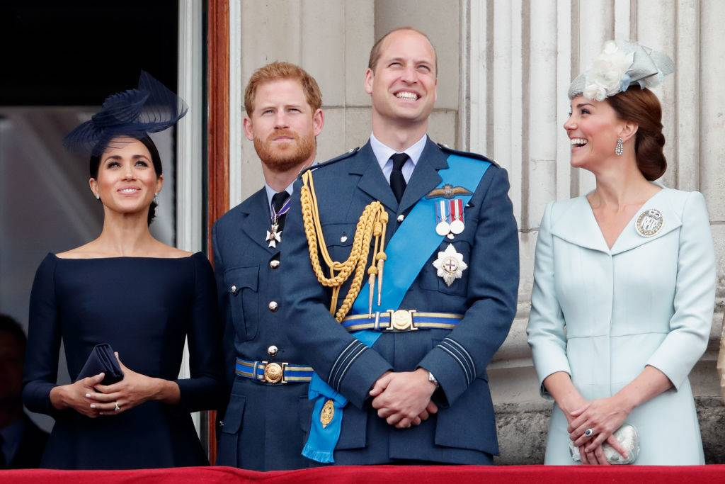 meghan markle, prince harry, prince william, and kate laughing in 2018