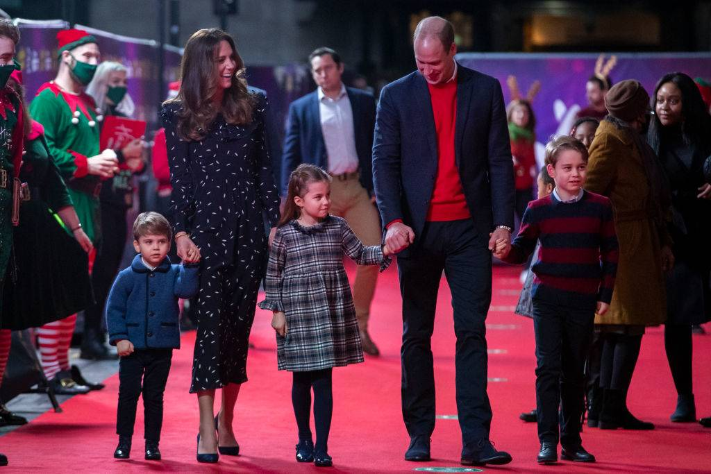 Prince William, Duke of Cambridge and Catherine, Duchess of Cambridge with their children, Prince Louis, Princess Charlotte and Prince George, attend a special pantomime performance