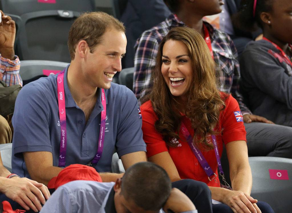 Prince William, Duke of Cambridge and Catherine, Duchess of Cambridge share a joke as they clap whilst watching the track cycling