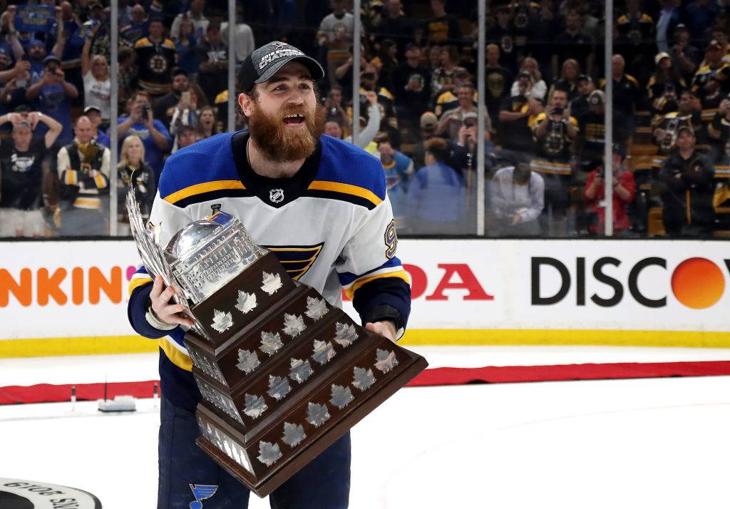Ryan O'Reilly #90 of the St. Louis Blues celebrates with the Conn Smythe Trophy