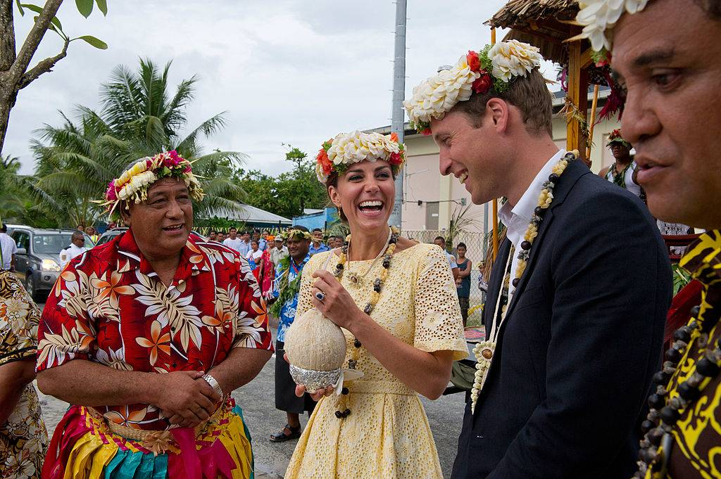 Prince William, Duke of Cambridge and Catherine, Duchess of Cambridge drink coconut milk from a tree