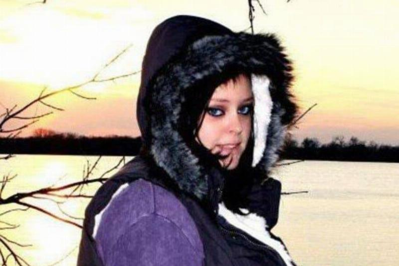 Valarie Watts is pictured in a warm coat by a lake.