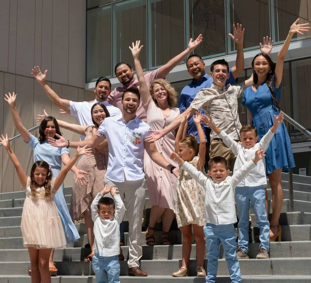 The entire Willis family, including all 12 children, celebrate the recent adoption on courthouse steps.