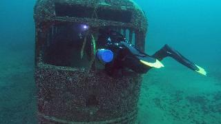 A diver swims into an underwater bus in Dutch Springs, Pennsylvania.