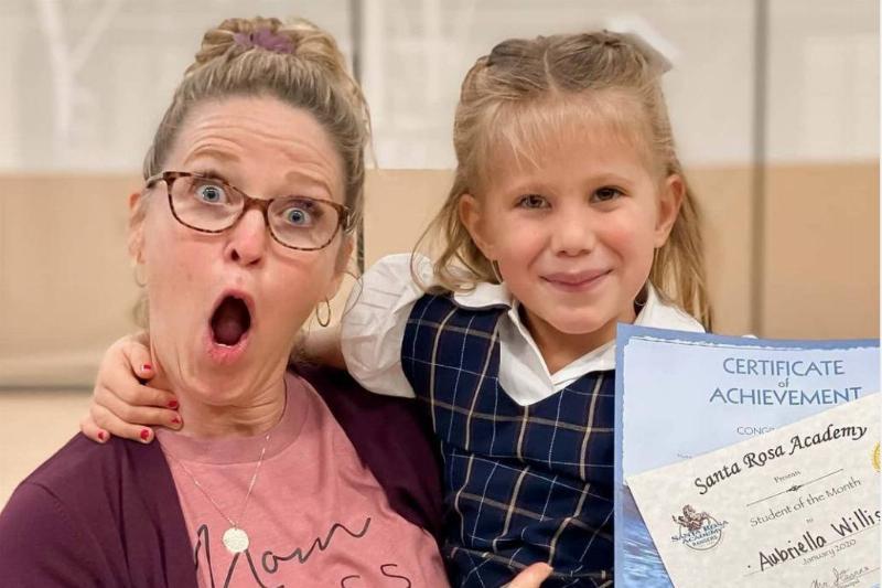Pam celebrates with her child Aubriella, who won a student award in Kindergarten.