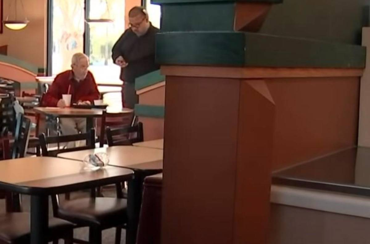 Travis Coye is seen at Mr. Doug's table from a distance.