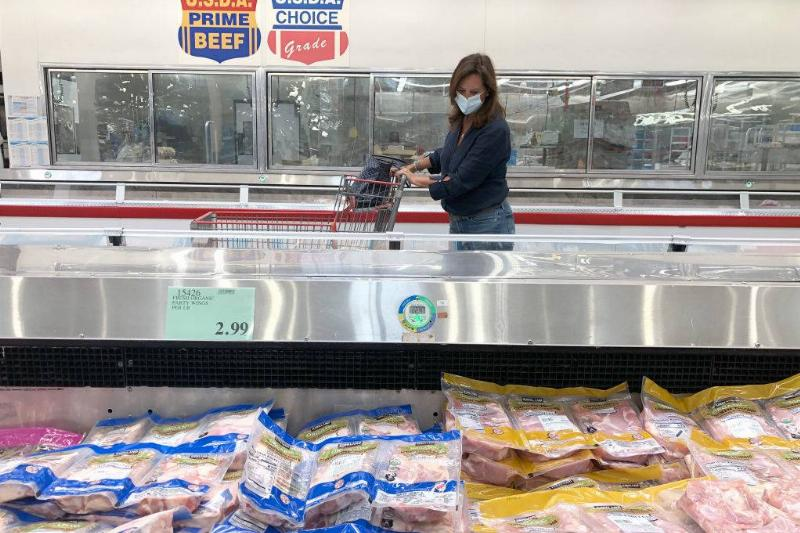 A customer shops for meat at a Costco