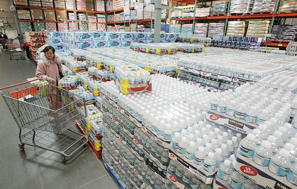 A Costco customer shops for bottled water