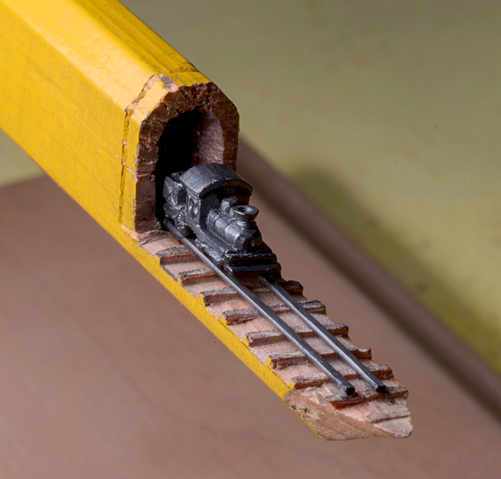 Carved train travels through a pencil