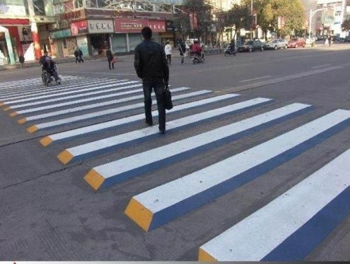Crosswalk optical illusions to slow down drivers