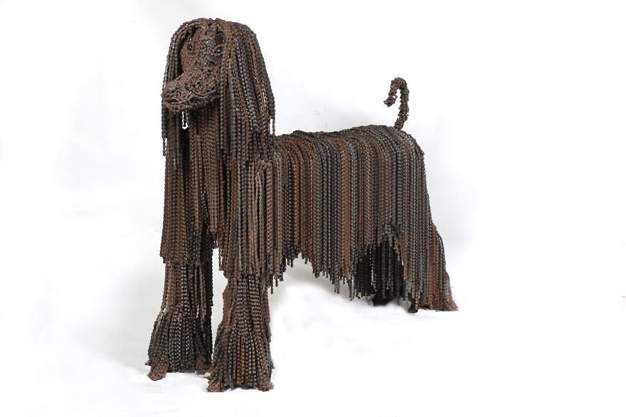 Dog sculpture with bicycle chains