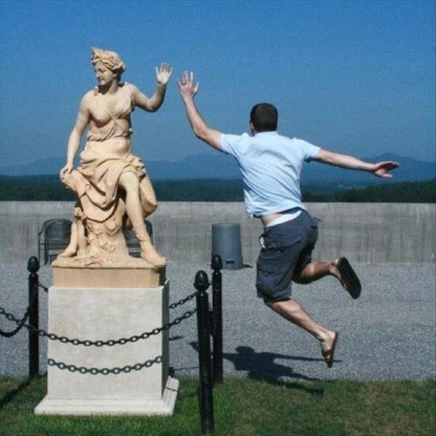 Funny High Five With Statue