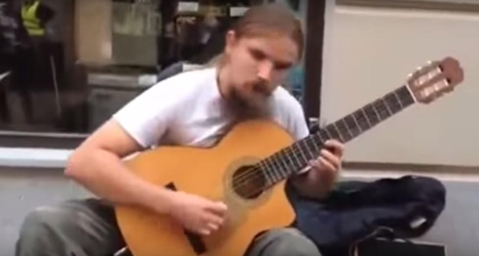 Guitar Playing street performer