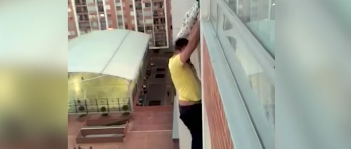 This Guy Hung From A Building To Save A Dog