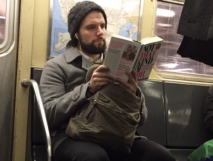 Hot dudes reading books on the subway