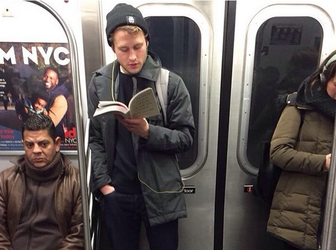 Hot dudes reading on the train