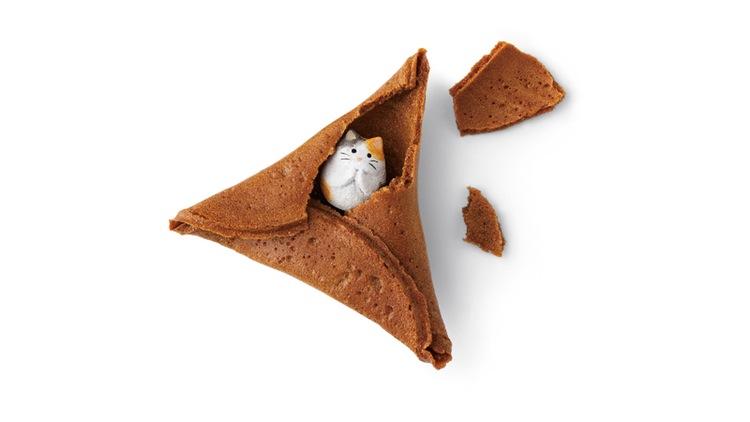 Miniature Cat Inside a fortune cookie