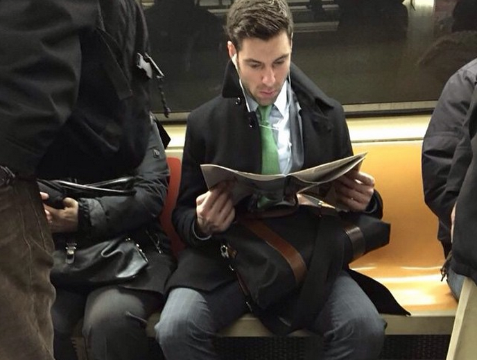 These Hot Dudes read on a subway train