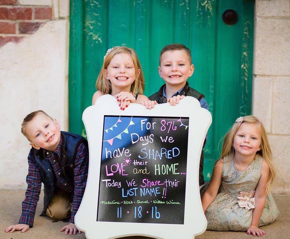 family -holding-sign.jpg