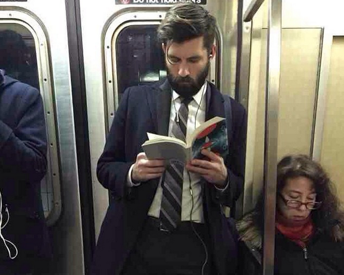 hot dudes reading on the subway