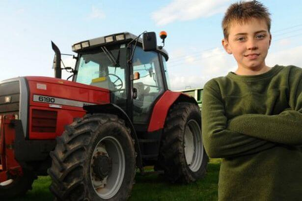 tom-phillips-and-the-tractor-used-to-save-his-dad-from-an-angry-bull-824752299.jpg